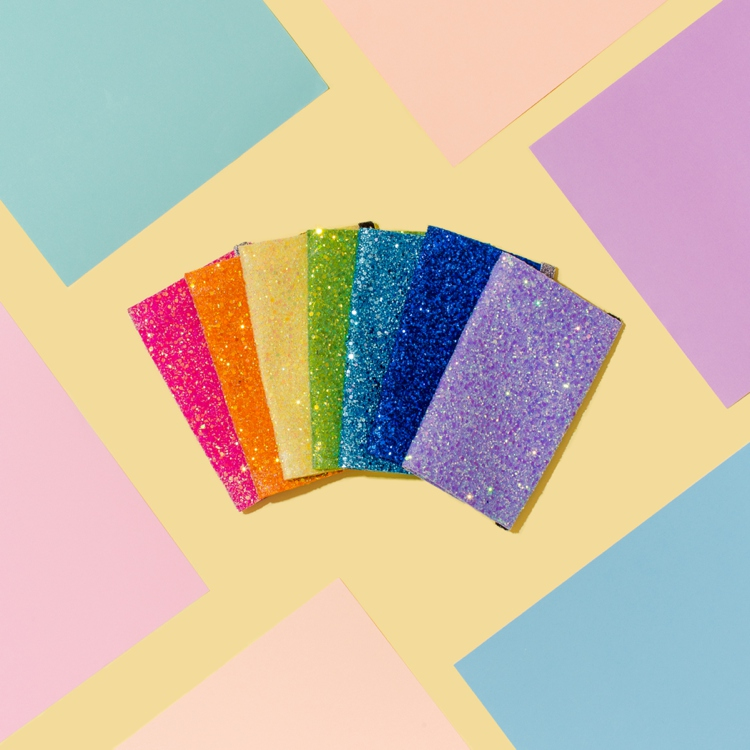 Sparkly colourful product photography and styling for Crown & Glory by Marianne Taylor.