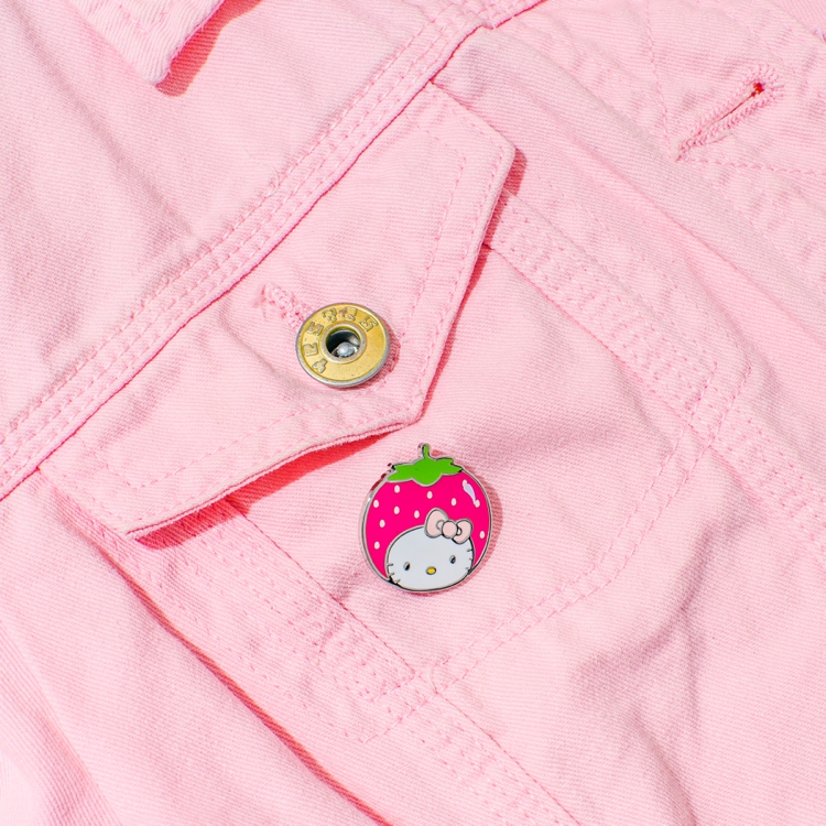 Colourful product photography and styling of Hello Kitty pins by Marianne Taylor.