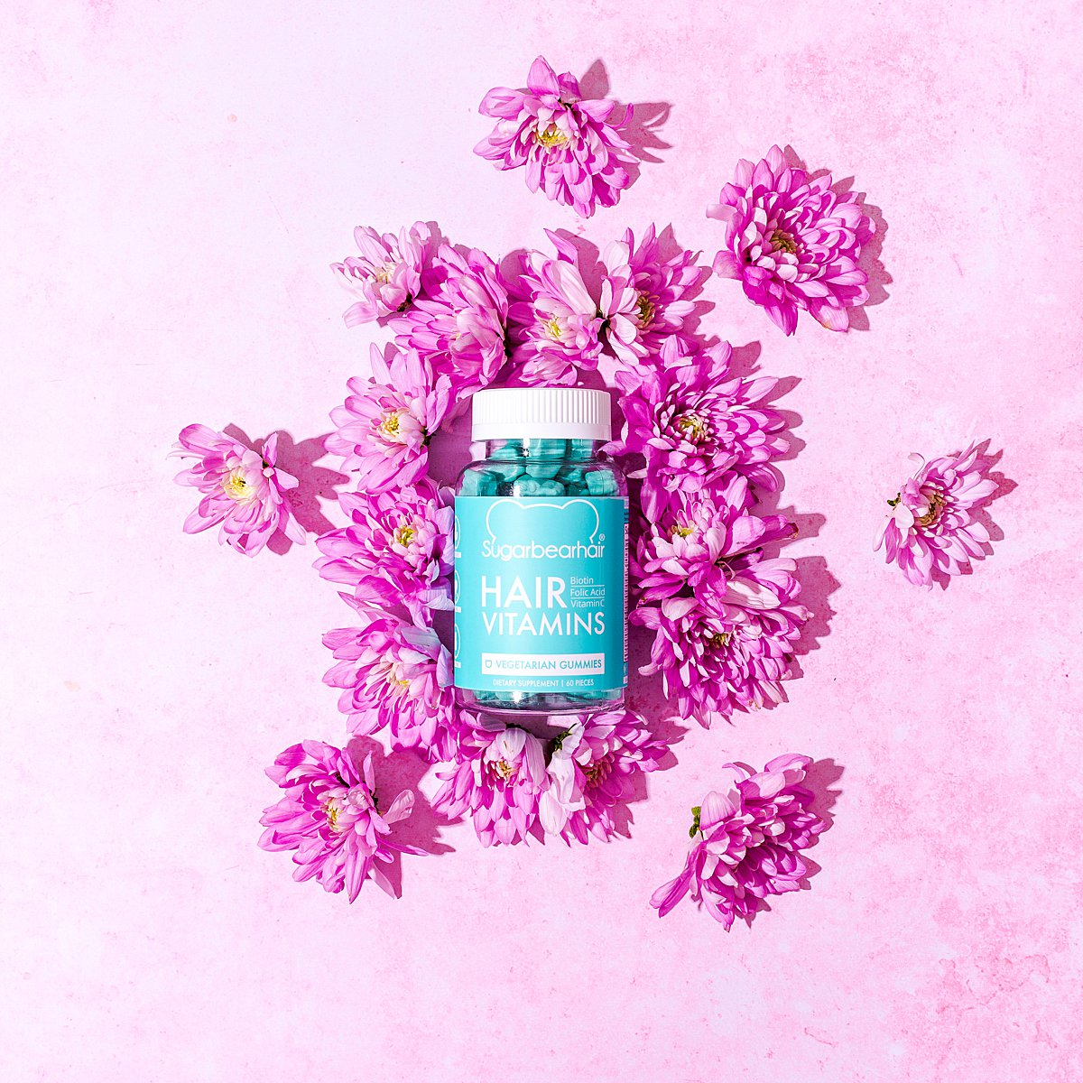 Cute colourful content creation for SugarBearHair vitamin supplements. Styled product stills photography by Marianne Taylor.